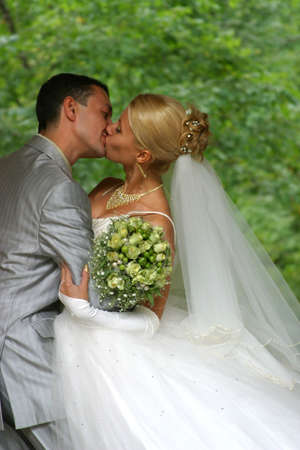 Recently married pair has kissed in park photo