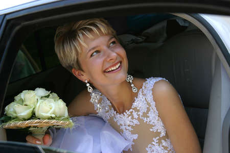 The laughing bride in the car Stock Photo - 542504