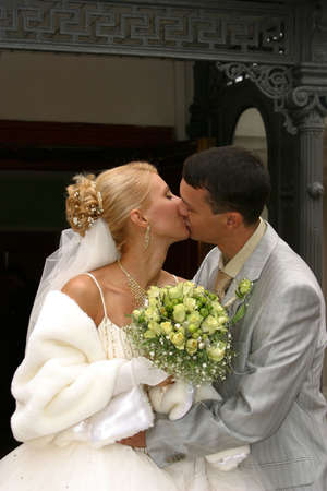 Newly-married couple kissed photo