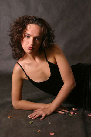 Portrait of the young girl in a black dress photo