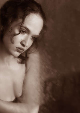 Portrait of the woman in reflection of a wet mirror. bw+sepia Stock Photo