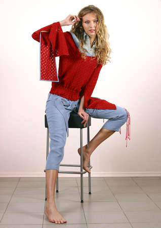 barefooted: The beautiful barefooted blonde in a red jacket