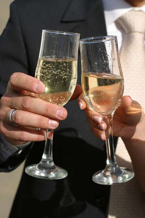 Glass of champagne in a hands of the groom and bride Stock Photo - 554362