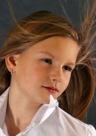 developing: Portrait of the girl close-up with developing hair Stock Photo