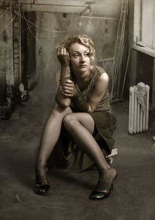 alienation: Portrait of attractive sad lady, chin on her hand. Retro style