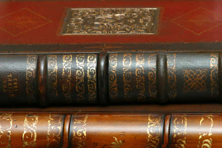 issued: Two ancient books in leather bindings issued in 1882