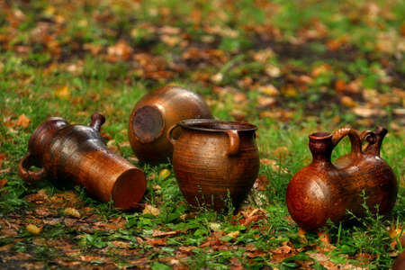 addressee: Damp pots on a grass Stock Photo