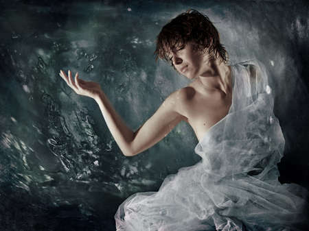 rapture: The image of the girl wrapped up in a fabric on a background of bubbles.