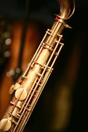 Vintage Saxophone on black background photo