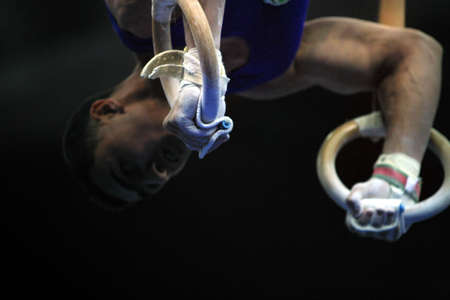 Close up of the gymnast competing on rings Stock Photo - 626490