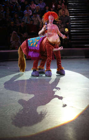 centaur: The clown in an image of the centaur on a circus ring Stock Photo