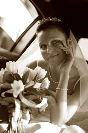elation: Beautiful the bride in car. bw+sepia Stock Photo