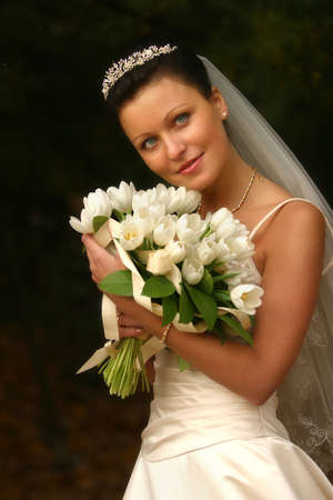 Beautiful the bride with a bouquet from tulips