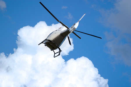 motor officer: The helicopter in the sky with clouds
