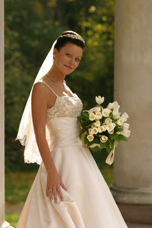 debutante: Beautiful bride with bouquet in park Stock Photo