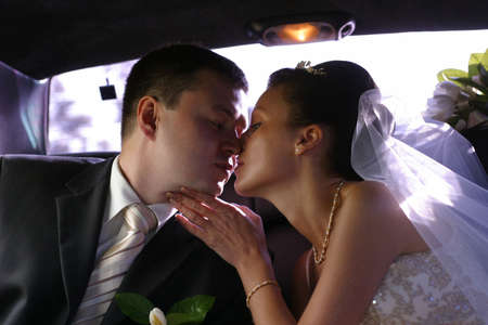 Kiss of a newly-married couple Stock Photo - 720383