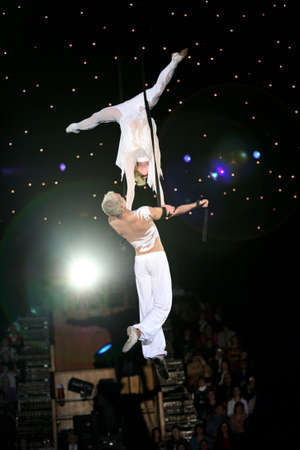 trapeze: Two air acrobats carry out exercise on a circus ring Stock Photo
