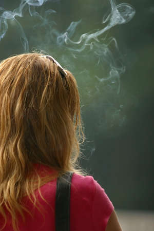 revolved: The woman stands a back in a smoke