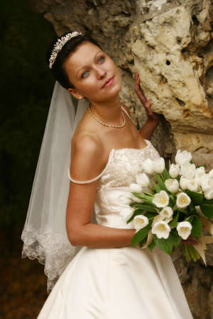 debutante: Beautiful the bride with a bouquet from tulips