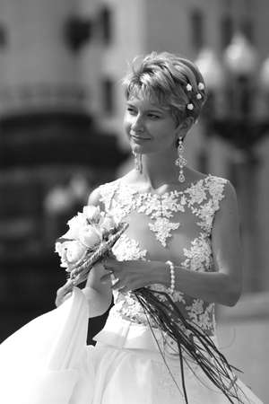 Beautiful bride with bouquet in street. b/w Stock Photo - 828212