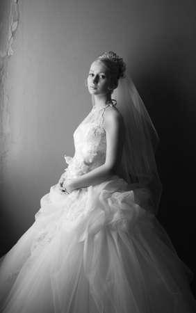 debutante: Beautiful bride in dress with flowers. bw