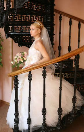 debutante: The beautiful bride with a bouquet in an interior Stock Photo