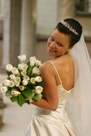 Beautiful the bride with a bouquet from tulips Stock Photo - 845336