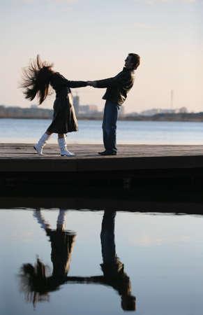 The in love pair walks on the bridge photo