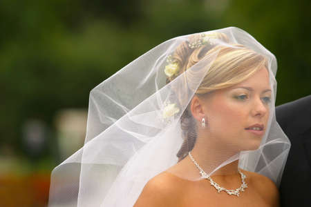 elation: The beautiful bride in movement under a veil