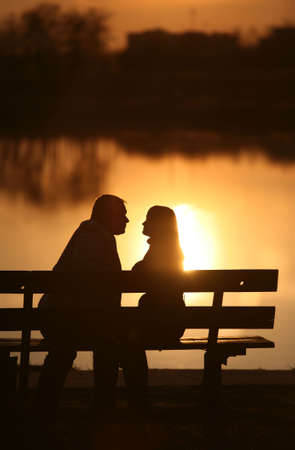 The man and the woman on a sunset photo