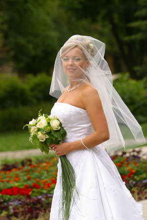 contestant: Portrait of the smiling beautiful bride in park