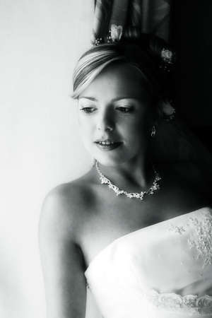 Portrait of the smiling beautiful bride. bw+blue tone photo
