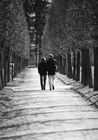 The man and the woman walk in park, bw photo