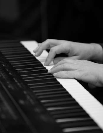 The man plays on a piano. b/w  Stock Photo - 888668