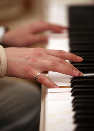 The image of the piano and mans hands photo