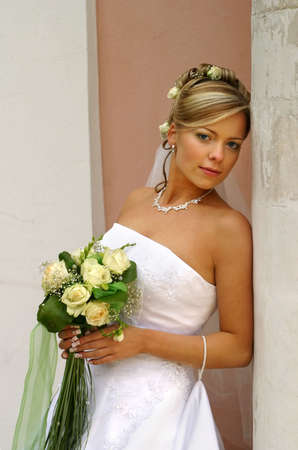 finally: The beautiful bride with a bouquet from roses  Stock Photo