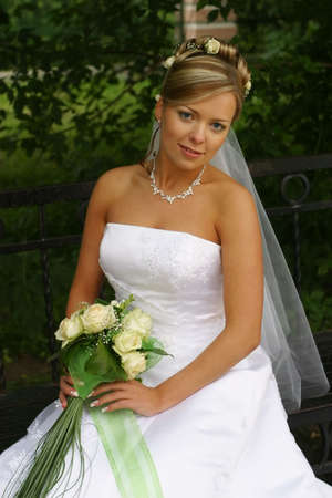 The beautiful bride with a bouquet from roses Stock Photo - 898945