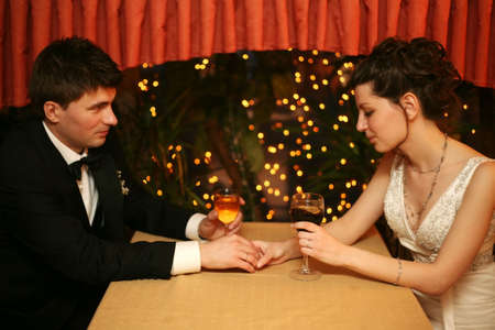 Newly-married couple sharing a glass of wine in restaurant, celebrating or on romantic date Stock Photo - 898949