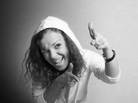 The cheerful young girl in a hood photo