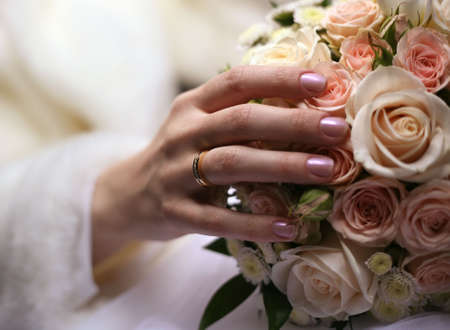The bride holds a wedding bouquet photo