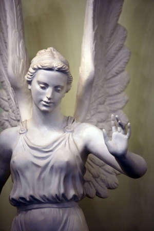 Statue of a sad angel from a stone