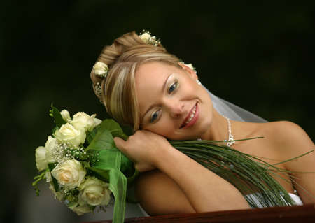 Portrait of the beautiful bride with a bouquet Stock Photo - 956461