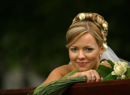 contestant: Portrait of the beautiful bride with a bouquet