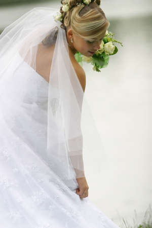 Portrait of the beautiful bride with a bouquet Stock Photo - 956460