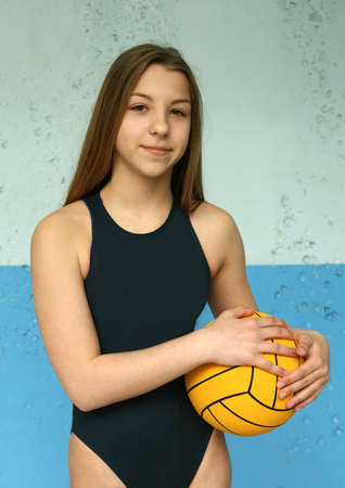 waterpolo: Portrait of the girl with a ball
