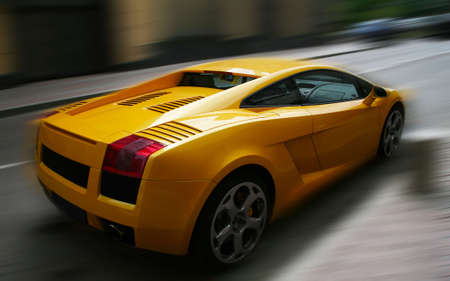 respectable: The image of the yellow respectable automobile on a dim background
