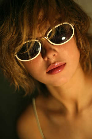 appealing: The attractive girl in solar glasses