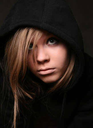 bullied: Portrait of the young girl in a black hood