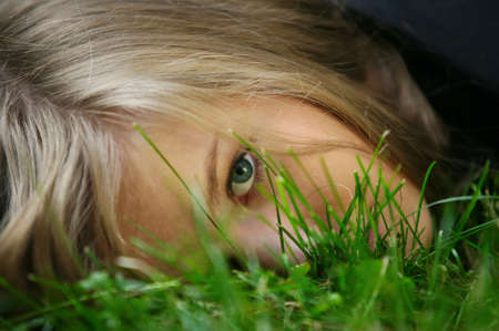 The girl in a grass. The face close-up Stock Photo - 1291052