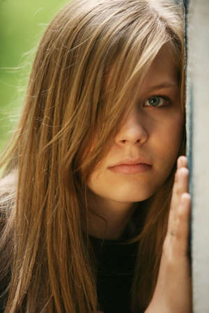 The young girl about a wall, looking frustration Stock Photo - 1291053